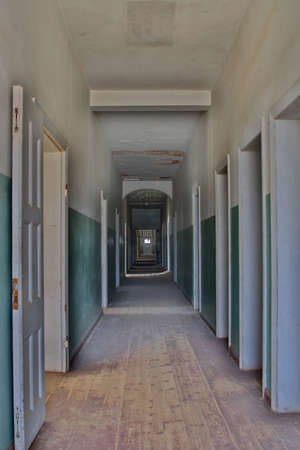 Hallway of the former hospital of Kolmanskop, Namibia photo