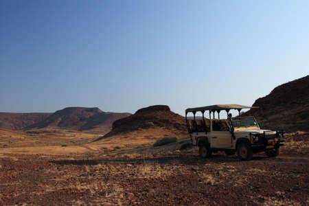 Safari vehicel in the desert landscape of Damaraland, Namibia photo