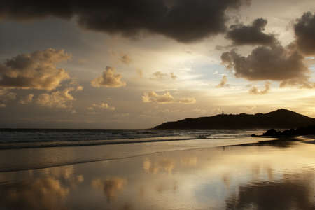 Beach of Byron Bay, Australia, at early morning with the lighthouse in the background. photo