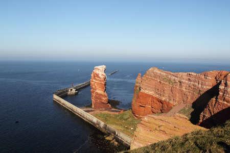 Cliff line of Heligoland with the Tall Anna, the landmark of Heligoland. photo
