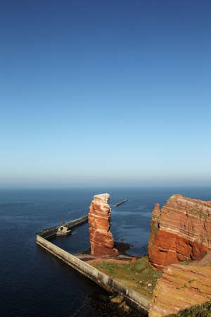 bight: Cliff line of Heligoland with the Tall Anna, the landmark of Heligoland.