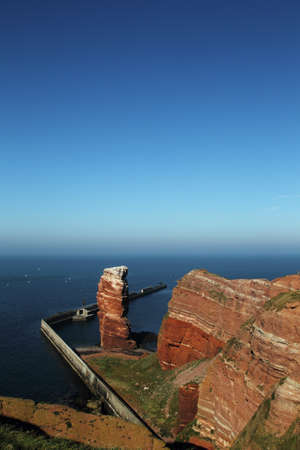 Cliff line of Heligoland with the Tall Anna, the landmark of Heligoland. photo