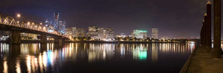 ligh: Portland, Oregon Panorama.  Night scene with ligh reflections on the Willamette River Stock Photo
