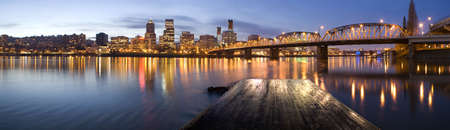 Portland, Oregon Panorama.  Night scene with light reflections on the Willamette River photo
