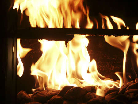 Burning Fire on BBQ Grill at Night. Stock Photo