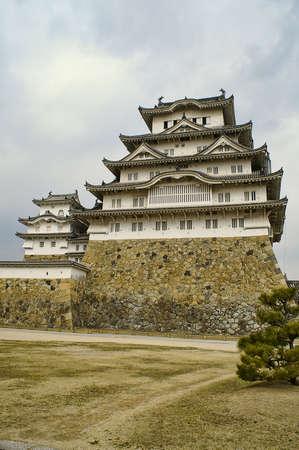 Ancient Samurai Castle of Himeji with Blue Cloudy Sky.  Japan.