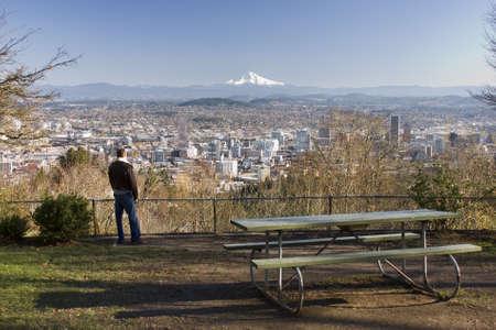 Male model overlooking city of Portland, Oregon. Stock Photo - 6082371