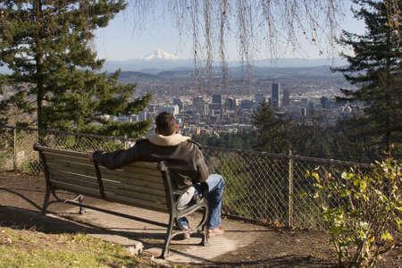 Male model overlooking city of Portland, Oregon.