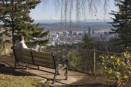 Male model overlooking city of Portland, Oregon. Stock Photo - 6082373