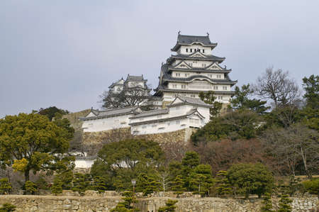 Ancient Samurai Castle of Himeji with Blue Cloudy Sky.  Japan.