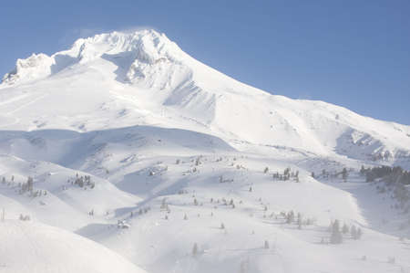 Beautiful Vista of Mount Hood in the Pacific Northwest with Blue Skies and the wind blowing through the snow. Stock Photo - 6166969