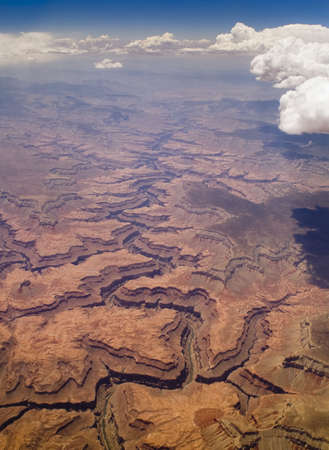 Aerial view of Grand Canyon in Arizona USA with shadows being cast by the Clouds in the Sky.