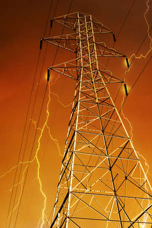 electric grid: Dramatic Image of Electricity Pylon with Lightning in Background.