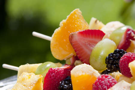 Fruit Kebab made of Oranges, Strawberries, Grapes, Blackberries, Raspberries.  Shallow Depth of Field.