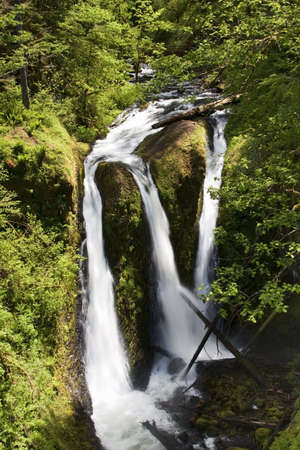 oregon cascades: Beautiful Image of three flowing waterfalls on Ainsworth Hiking Trail.