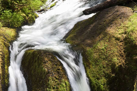 Beautiful Image of a flowing river on Ainsworth Hiking Trail. photo
