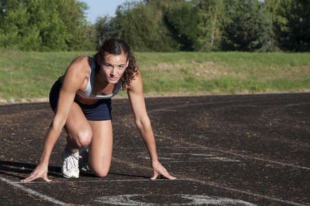 Portrait of a Young, Attractive Female Athlete on Race Track. Stock Photo