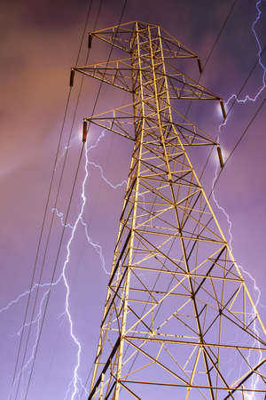 Dramatic Image of Electricity Pylon with Lightning in Background. photo