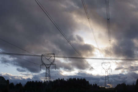 Dramatic Image of Electricity Pylons on a Stormy Sunset. photo