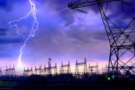 high voltage: Dramatic Image of Power Distribution Station with Lightning Striking Electricity Towers.