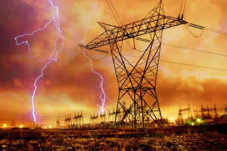 Dramatic Image of Power Distribution Station with Lightning Striking Electricity Towers.