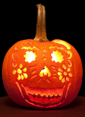 Happy Jack O Lantern with intricate pattern carved out. Stock Photo