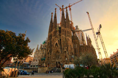 familia: BARCELONA, SPAIN - FEBRUARY 25: Sagrada Familia on February 25, 2012: La Sagrada Familia - the impressive cathedral designed by Gaudi, which is being build since 19 March 1882 and is not finished yet. Editorial