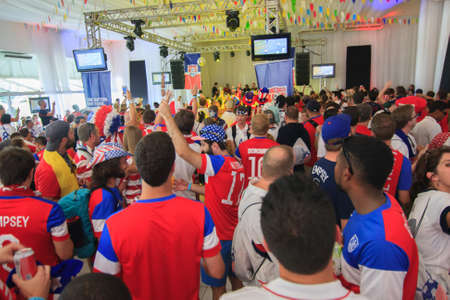 outlaws: MANAUS, BRAZIL- JUNE 22: American Soccer  Football Fans at the American Outlaws party prior to the US vs Portugal match.  Fans are dressed wearing the USA team jersey and American colors. Editorial