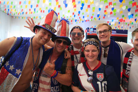 MANAUS, BRAZIL- JUNE 22: American Soccer  Football Fans at the American Outlaws party prior to the US vs Portugal match.  Fans are dressed wearing the USA team jersey and American colors. Editorial