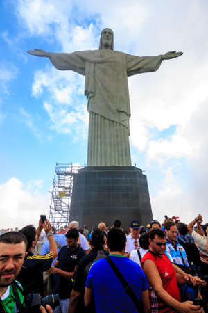 rio: RIO DE JANEIRO, BRAZIL - JUNE 16: Hundres of FIFA World Cup Fans visit Christ the Redeemer, located on top of Corcovado, Rios highest mountain at approximately 2,330 feet above sea level.