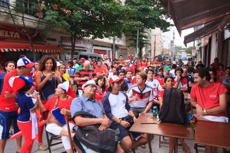 RIO DE JANEIRO - JUNE 18: A crowd of Chilean Fans gather in the vicinity of Maracana Stadium to watch the Chile vs Spain match.