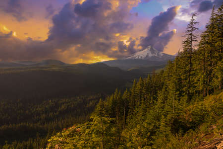 mount hood national forest: Majestic Sunset View of Mt  Hood with drmatic skies during the summer months  Stock Photo