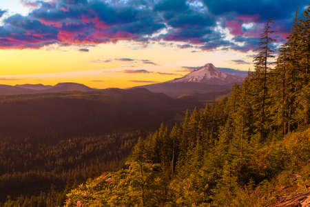 mt  hood national forest: Majestic Sunset View of Mt  Hood with dramatic skies during the summer months