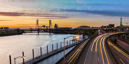 willamette: Portland, Oregon view of the Steel Bridge with light reflections on the Willamette River Stock Photo
