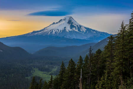 hood: Majestic View of Mt. Hood on a bright, colorful sunset during the summer months.