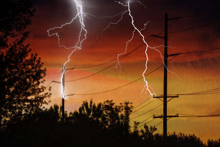 conductor electricity: Silhouette of Power Lines being struck by lightning. Stock Photo