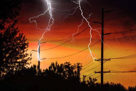 power distribution: Silhouette of Power Lines being struck by lightning. Stock Photo