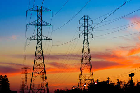 outdoor electricity: Beautiful Silhouette of Electricity Towers during Sunset.