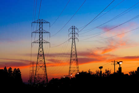 conductor electricity: Beautiful Silhouette of Electricity Towers during Sunset.