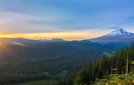 mt  hood: Majestic View of Mt. Hood on a bright, colorful sunset during the summer months Stock Photo