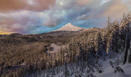 mt  hood national forest: Majestic View of Mt. Hood on a Stormy Sunset during the Winter months. Stock Photo