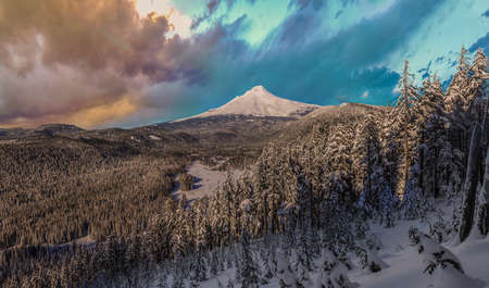 mount hood national forest: Majestic View of Mt. Hood on a stormy evening during the Winter months.