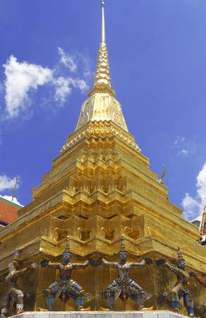 Golden Pagoda with Giant Statue at the base, Bangkok Grand Palace, Wat Phra Kaeo Bangkok Thailand Stock Photo - 13649786