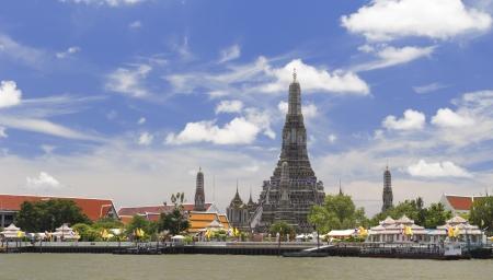 Wat Arun (Temple of Dawn) Across Chao Phraya River With Blue Sky photo