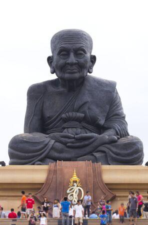 respecting: Close up facial detail Buddhism black metal statue Stock Photo