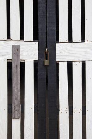 White and black wood door with old lock photo