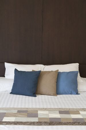 Bed headboard and Pillows photo