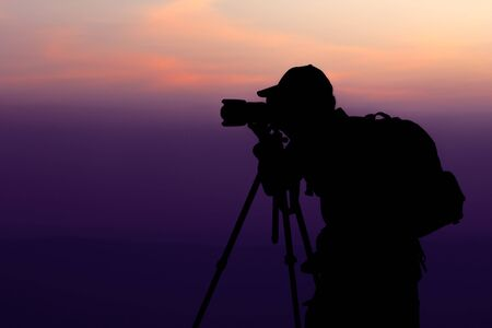 videographer: Photographer take a shot at Top of Mountain