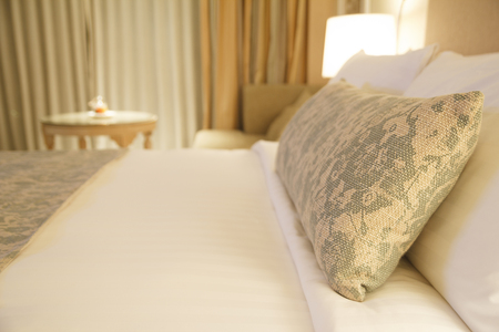 Shallow depth of field on Fancy pillow with bedding headboards