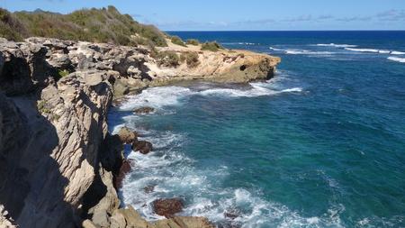 Shipwreck rocky beach near Lihue, Kauai (Hawaii, USA)